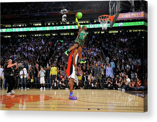 Nba Pro Basketball Acrylic Print featuring the photograph Dwight Howard and Nate Robinson by Jesse D. Garrabrant