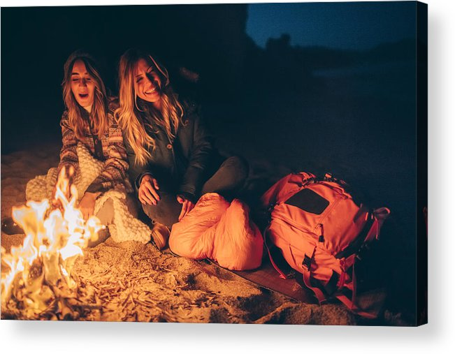 Hipster Acrylic Print featuring the photograph Friends enjoy evening on the beach by the log fire by AleksandarNakic