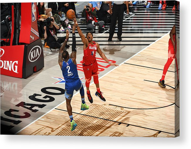 Nba Pro Basketball Acrylic Print featuring the photograph Giannis Antetokounmpo and Lebron James by Garrett Ellwood