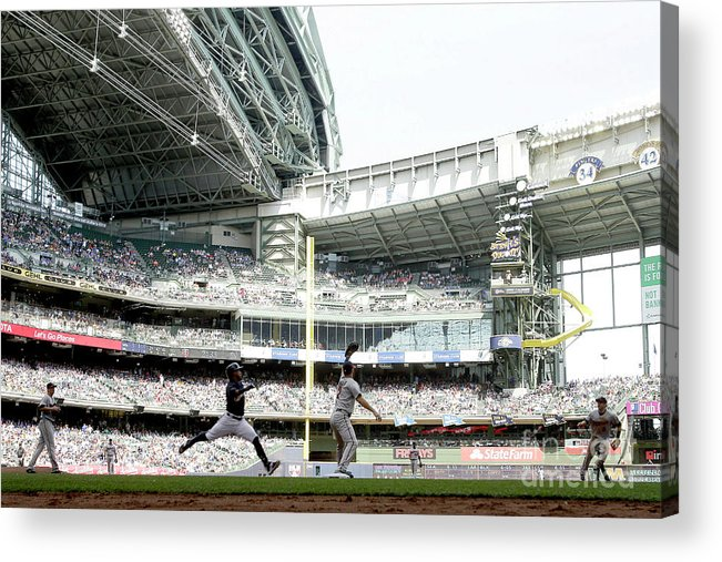 Joe Mauer Acrylic Print featuring the photograph Joe Mauer and Jean Segura by Mike Mcginnis
