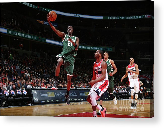 Nba Pro Basketball Acrylic Print featuring the photograph John Wall and Tony Snell by Ned Dishman