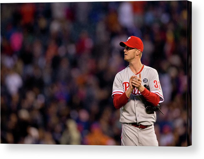 Defeat Acrylic Print featuring the photograph Justin Morneau and Kyle Kendrick by Justin Edmonds