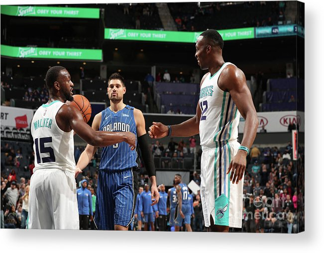 Kemba Walker Acrylic Print featuring the photograph Kemba Walker and Dwight Howard by Kent Smith