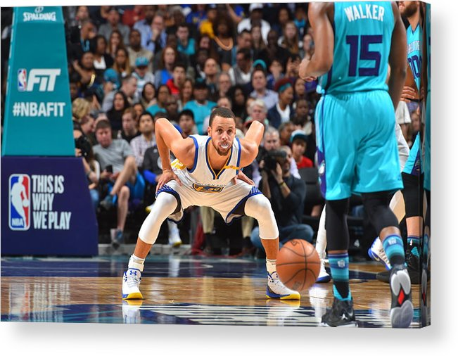 Kemba Walker Acrylic Print featuring the photograph Kemba Walker and Stephen Curry by Jesse D. Garrabrant