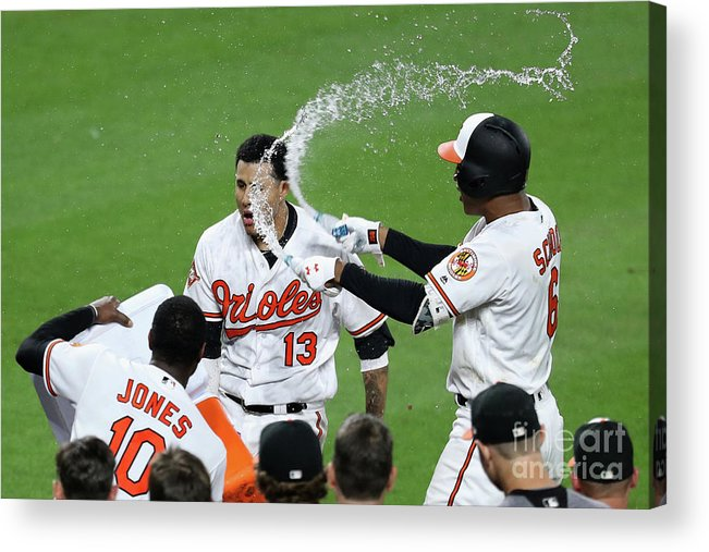 People Acrylic Print featuring the photograph Manny Machado, Jonathan Schoop, and Adam Jones by Rob Carr