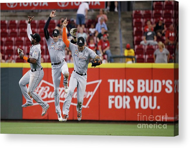 Great American Ball Park Acrylic Print featuring the photograph Marcell Ozuna, Christian Yelich, and Giancarlo Stanton by Joe Robbins