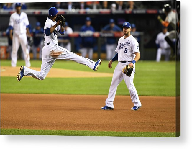 Playoffs Acrylic Print featuring the photograph Mike Moustakas and Alcides Escobar by Rob Tringali