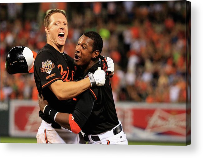American League Baseball Acrylic Print featuring the photograph Nick Hundley and Adam Jones by Rob Carr