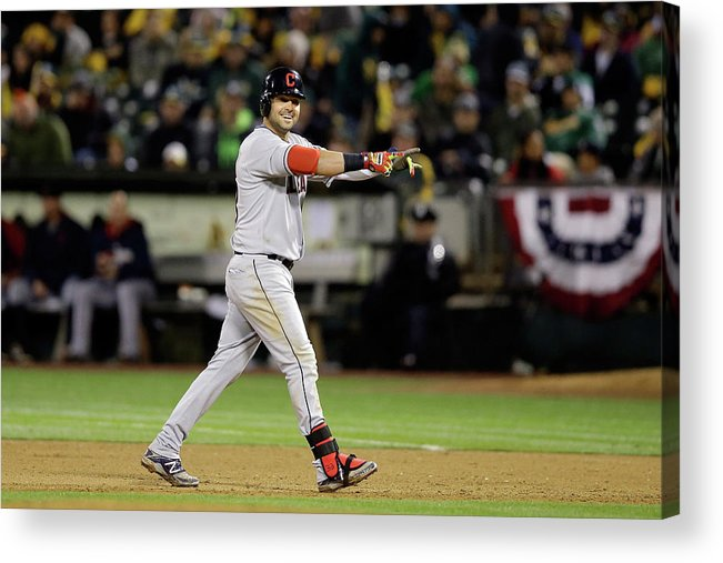 American League Baseball Acrylic Print featuring the photograph Nick Swisher and Nyjer Morgan by Ezra Shaw