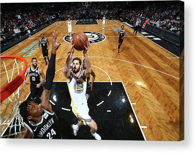 Nba Pro Basketball Acrylic Print featuring the photograph Omri Casspi by Nathaniel S. Butler