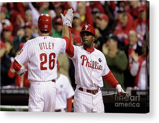 Game Two Acrylic Print featuring the photograph Ryan Howard, Jimmy Rollins, and Chase Utley by Rob Carr