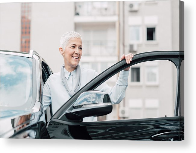 Corporate Business Acrylic Print featuring the photograph Senior Woman Smiling While Entering A Car by RgStudio
