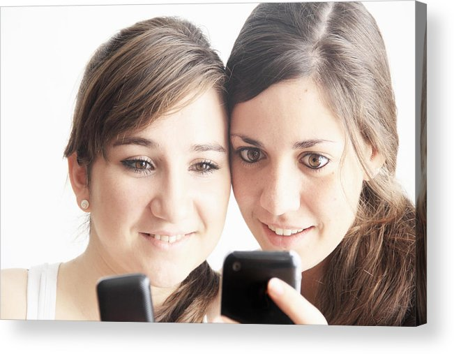 People Acrylic Print featuring the photograph Teenage girls using cell phones by Sigrid Gombert