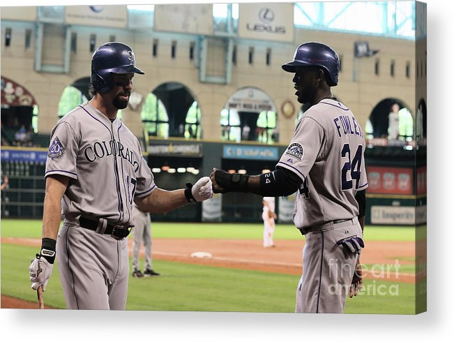 American League Baseball Acrylic Print featuring the photograph Todd Helton and Dexter Fowler by Scott Halleran