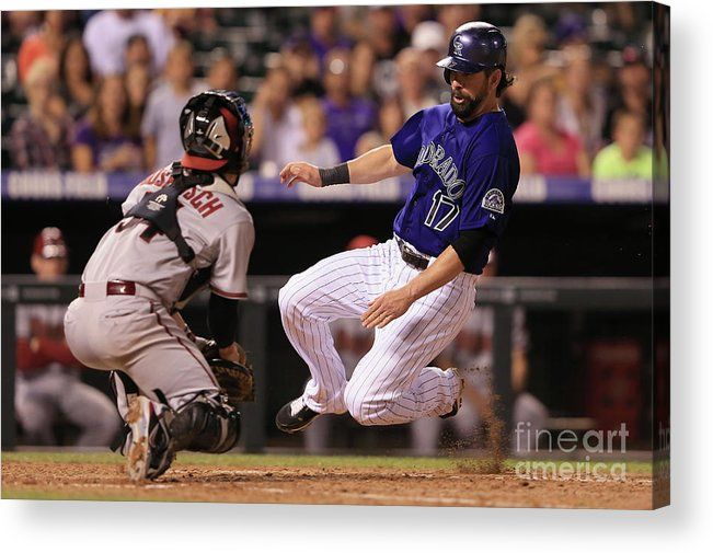 Baseball Catcher Acrylic Print featuring the photograph Todd Helton and Jordan Pacheco by Doug Pensinger