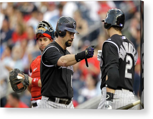 People Acrylic Print featuring the photograph Todd Helton and Troy Tulowitzki by Rob Carr