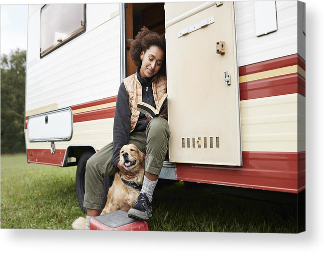 Pets Acrylic Print featuring the photograph Woman with dog reading book in motor van by Klaus Vedfelt