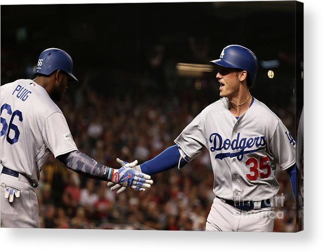 Three Quarter Length Acrylic Print featuring the photograph Yasiel Puig and Cody Bellinger by Christian Petersen