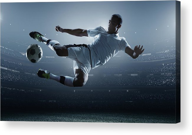Goal Acrylic Print featuring the photograph Soccer Player Kicking Ball In Stadium by Dmytro Aksonov