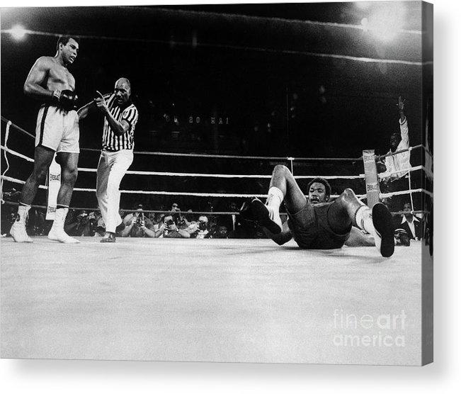 People Acrylic Print featuring the photograph Muhammad Ali Knocks George Foreman Onto by Bettmann
