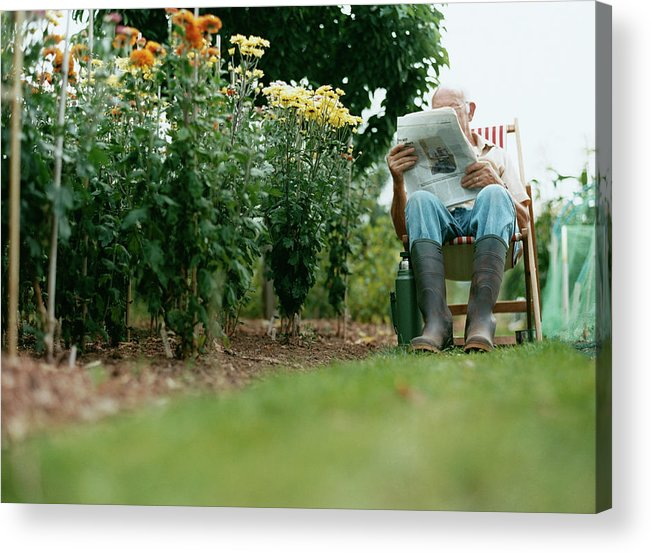 Grass Acrylic Print featuring the photograph Unrecognisable Man Sits Reading A by Iain Crockart