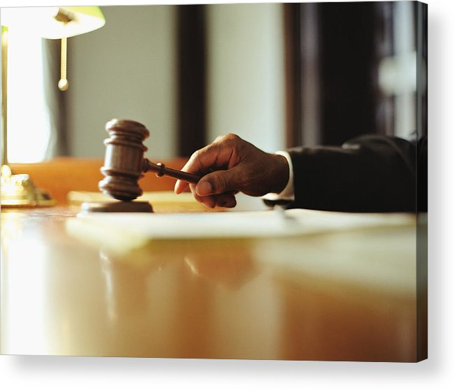 Punishment Acrylic Print featuring the photograph Male judge striking gavel in courtroom, close-up by Yellow Dog Productions