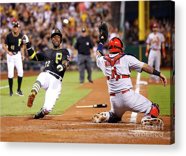 St. Louis Cardinals Acrylic Print featuring the photograph Yadier Molina and Andrew Mccutchen by Jared Wickerham