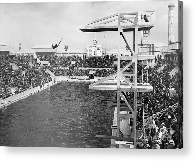 Diving Into Water Acrylic Print featuring the photograph American Diver Winning Gold Medal by Bettmann