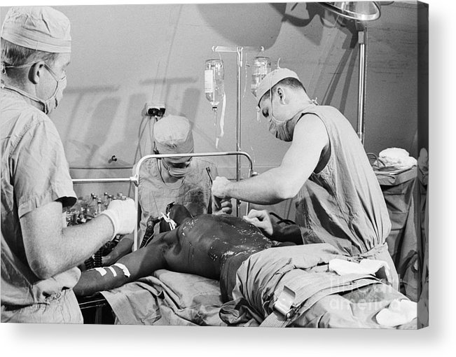 People Acrylic Print featuring the photograph Doctors Performing Surgical Procedure by Bettmann