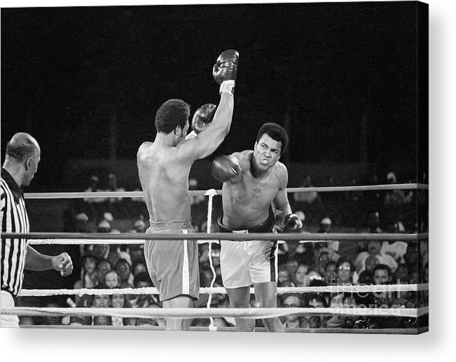 People Acrylic Print featuring the photograph Muhammad Ali Punching George Foreman by Bettmann