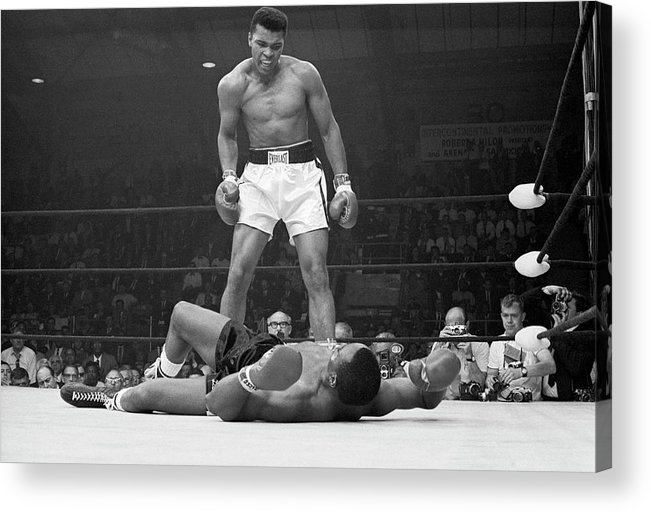 Heavyweight Acrylic Print featuring the photograph Muhammad Ali Taunting Sonny Liston by Bettmann