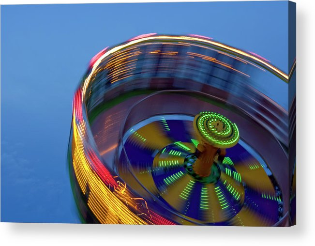 Carousel Acrylic Print featuring the photograph Multicolored Spinning Carnival Ride by By Ken Ilio