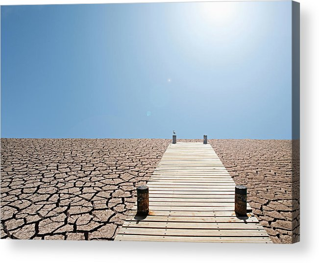 Environmental Damage Acrylic Print featuring the photograph Pier Over A Dry Lake Bed by John Lund