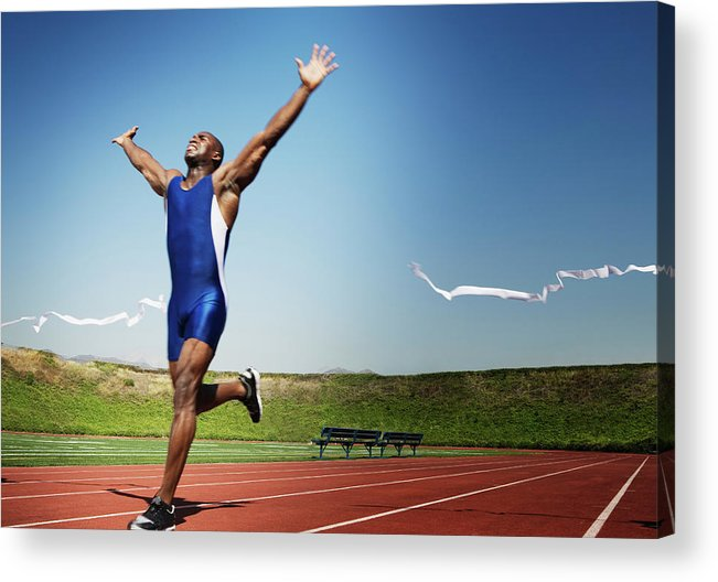 Human Arm Acrylic Print featuring the photograph Runner Crossing Finish Line by Jupiterimages