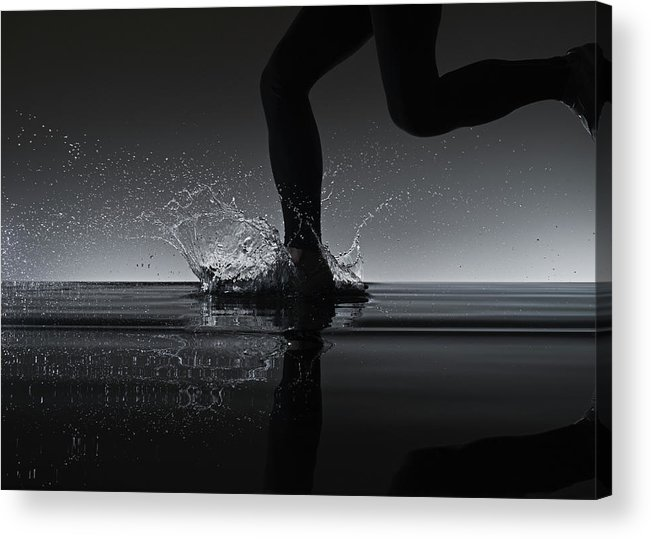 Recreational Pursuit Acrylic Print featuring the photograph Running Through Water by Jonathan Knowles