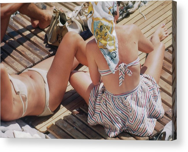 People Acrylic Print featuring the photograph Sunbathing In Nice by Michael Ochs Archives