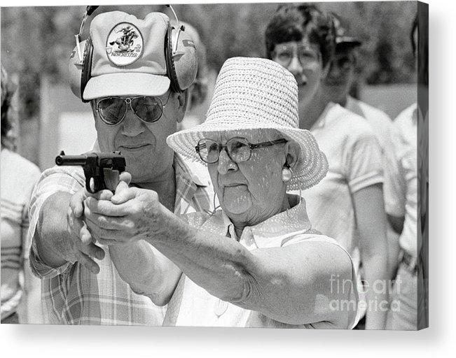1980-1989 Acrylic Print featuring the photograph Woman Practicing Firing A Gun by Bettmann