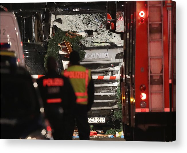 Berlin Acrylic Print featuring the photograph Lorry Drives Through Christmas Market In Berlin by Sean Gallup