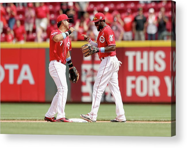 Great American Ball Park Acrylic Print featuring the photograph Brandon Phillips and Eugenio Suarez by Andy Lyons