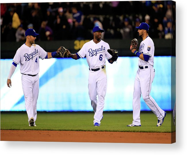 People Acrylic Print featuring the photograph Lorenzo Cain, Alex Gordon, and Paulo Orlando by Jamie Squire