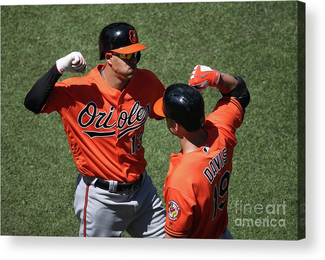 People Acrylic Print featuring the photograph Manny Machado and Chris Davis by Tom Szczerbowski