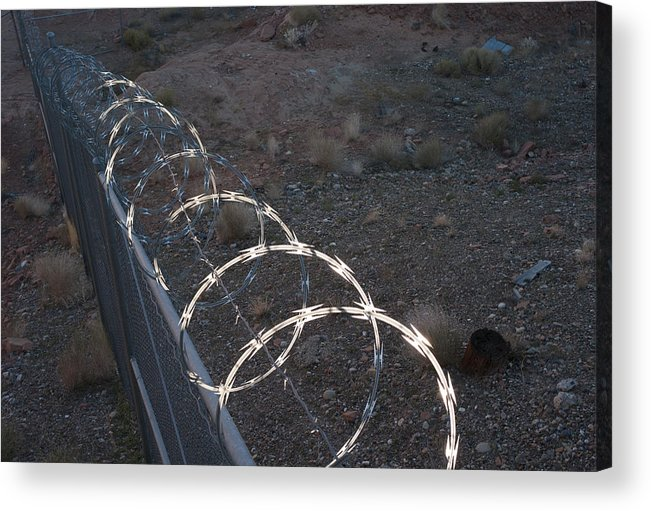 Geology Acrylic Print featuring the photograph Razor wire on a fence on the coast by Fotosearch