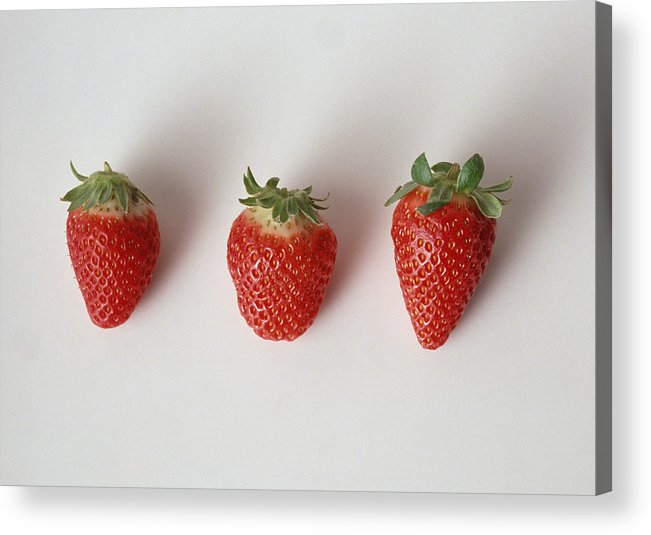 White Background Acrylic Print featuring the photograph Three strawberries in a row, close-up, white background by Isabelle Rozenbaum & Frederic Cirou