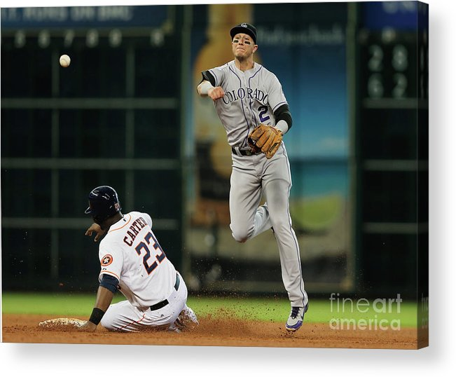 American League Baseball Acrylic Print featuring the photograph Troy Tulowitzki and Chris Carter by Scott Halleran