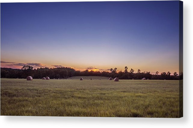 Hay Bales Acrylic Print featuring the photograph Hay Bales In A Field At Sunset by Todd Aaron