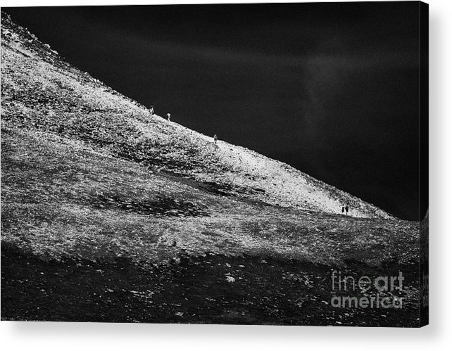 County Acrylic Print featuring the photograph climbers climbing ridge on Errigal mountain donegals highest peak against a blue sky between dunlewey and gweedore Donegal Republic of Ireland by Joe Fox