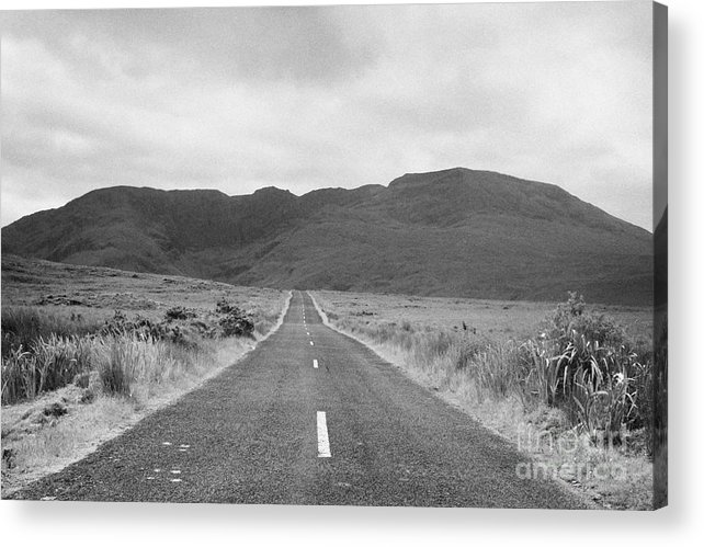 Ireland Acrylic Print featuring the photograph country road heading off into the Connemara mountains County Galway by Joe Fox