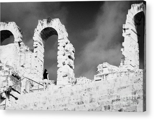 Tunisia Acrylic Print featuring the photograph Female Tourist Walks Up The Stepped Seating Area Towards Ruined Archways Of The Old Roman Colloseum At El Jem Tunisia by Joe Fox