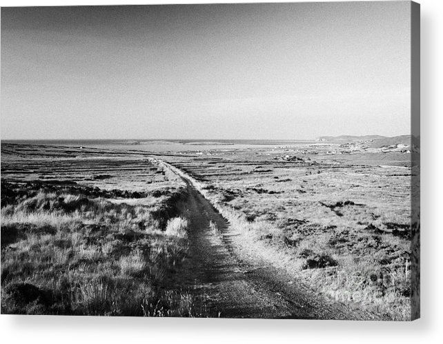 County Acrylic Print featuring the photograph isolated single track road over peat bog heading down to the sea Gweedore county Donegal Republic of Ireland by Joe Fox