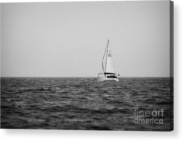 Ireland Acrylic Print featuring the photograph lone yacht off Rathlin Island against grey sky with sea County Antrim Northern Ireland by Joe Fox